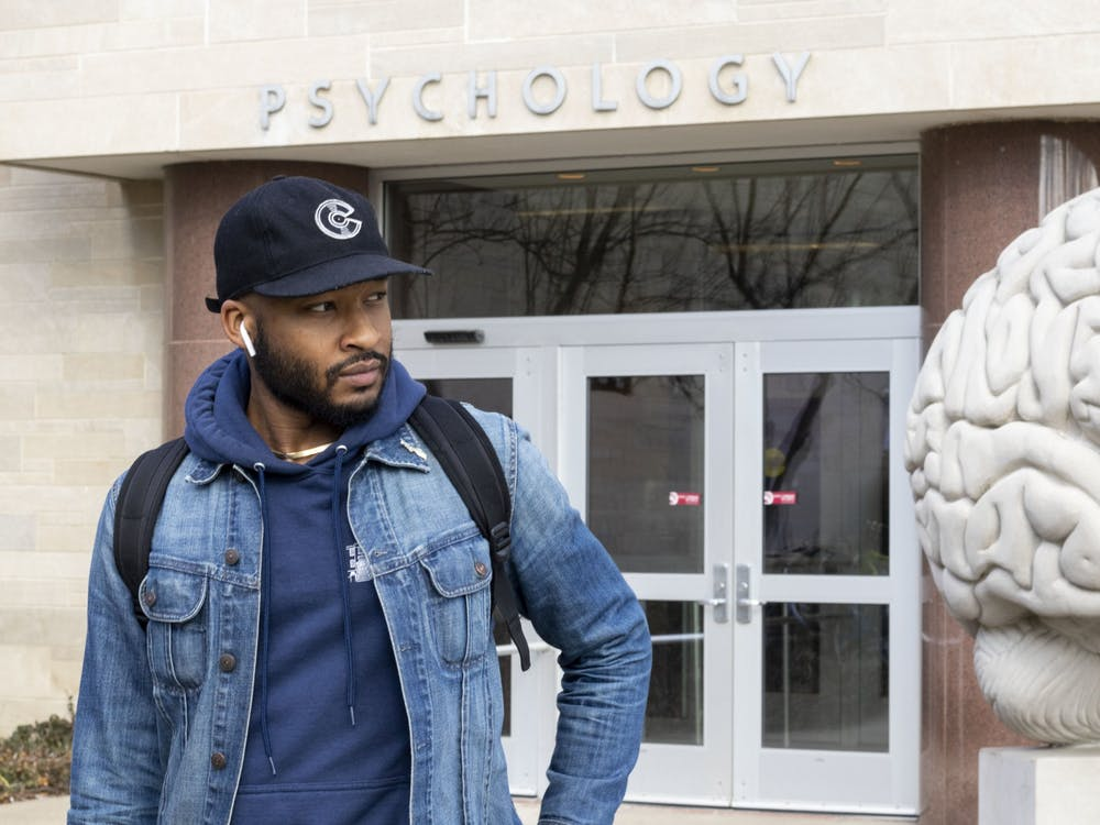 "Chrisjaan Smith poses for a headshot March 3 in front of the Psychology Building. ""Before I started my management group, I was an artist myself, and the first song I ever released was called 'Psychology,'"" Smith said. "" I feel like I thrive in business because of what I learned in psychology,"" Smith said."