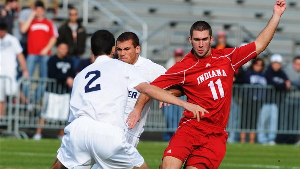 Sophomore forward Will Bruin dribbles past Butler's Matthew Hedges during the second round of the NCAA Men's Soccer Tournament on Sunday at Bill Armstrong Stadium. Indiana defeated Butler 1-0, and will play its third round match against North Carolina in Chapel Hill next Sunday.