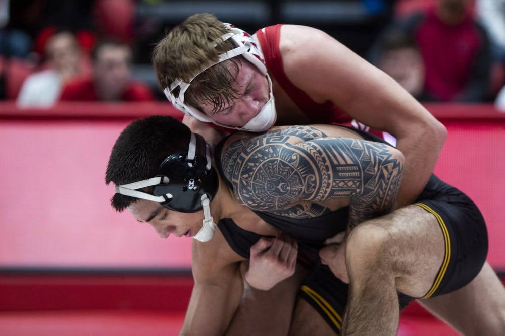 <p>Sophomore Graham Rooks wrestles senior Pat Lugo from the Iowa Hawkeyes Jan. 10 in Wilkinson Hall. IU will compete in the Big Ten Championships this weekend in Piscataway, New Jersey. </p>