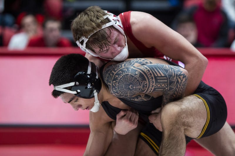 Sophomore Graham Rooks wrestles senior Pat Lugo from the Iowa Hawkeyes Jan. 10 in Wilkinson Hall. IU will compete in the Big Ten Championships this weekend in Piscataway, New Jersey.