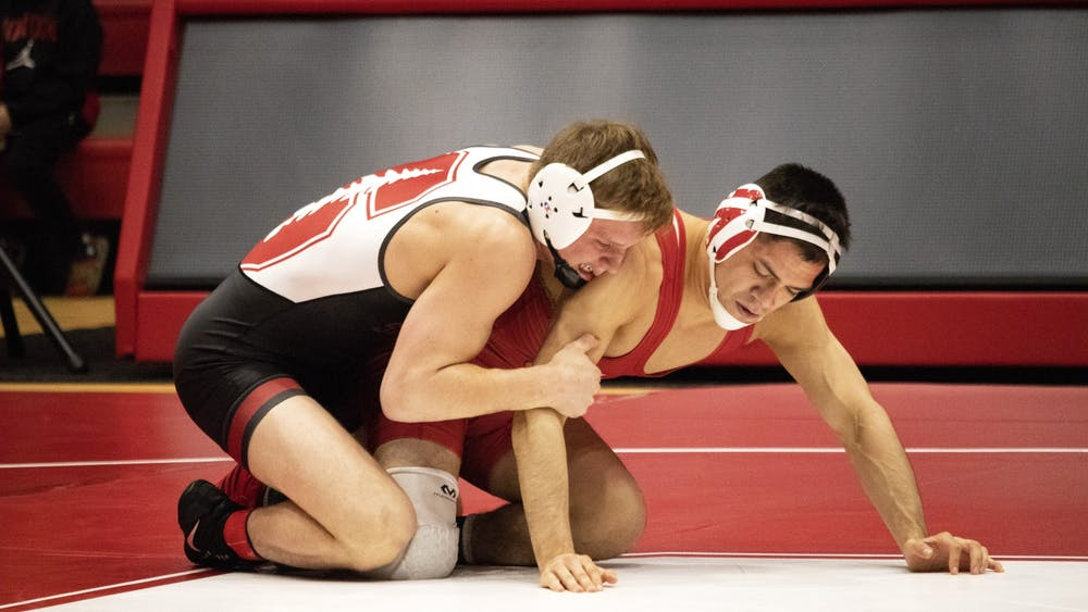 Then-junior Fernando Silva prepares to start a match against a Stanford University wrestler Feb. 9 in Wilkinson Hall. IU will compete in the Journeyman Tournament against 15 other schools this weekend.