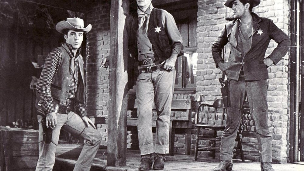 "Ricky Nelson, John Wayne and Dean Martin star in ""Rio Bravo."""