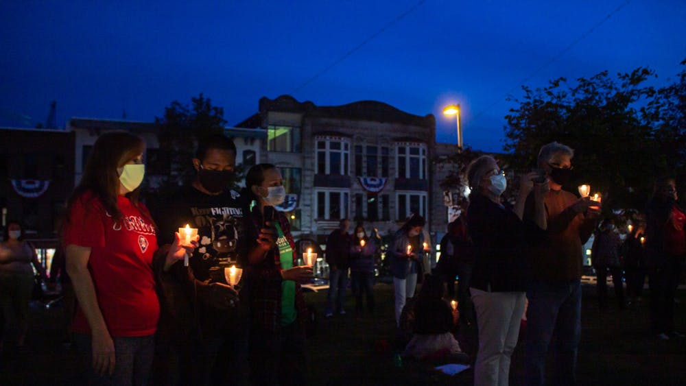 Attendees hold candles at the Homeless Memorial Vigil on Sept. 22 at the Monroe County Courthouse. The vigil Tuesday was the 17th annual memorial.