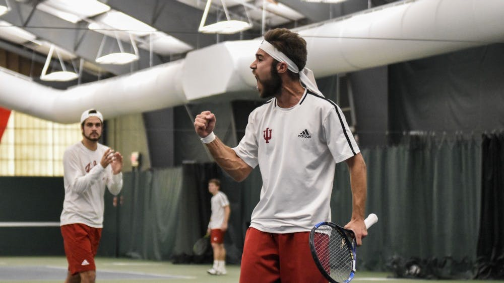 Then-junior Antonio Cembellin, now a senior, celebrates after winning a point during his 1-6, 6-3, 4-6 loss to Wisconsin on April 8, 2018, at the IU Tennis Center. IU will face Nebraska on Saturday.