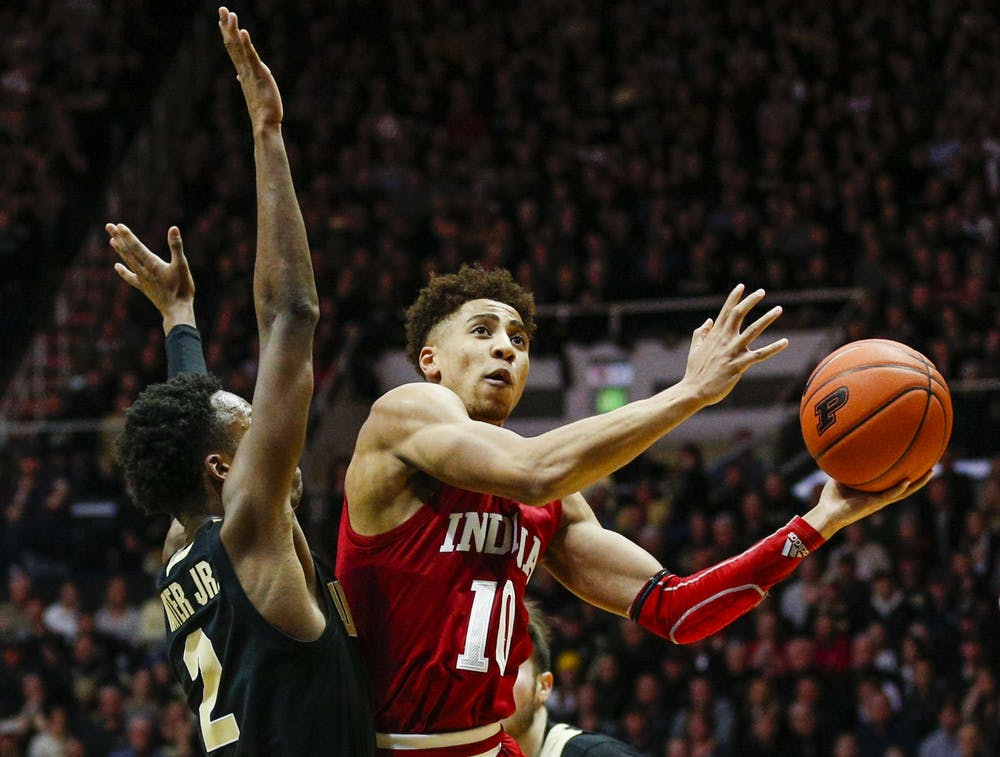 <p>Then-sophomore guard Rob Phinisee sneaks around a Purdue defender and makes a layup Feb. 27, 2020, at Mackey Arena in West Lafayette, Indiana. The Hoosiers will take on the Boilermakers Jan. 14 at Simon Skjodt Assembly Hall. </p>