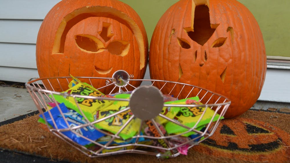 Pumpkins and candy are set out at different Manchester Manor apartments Oct. 26 from the past weekend. Many festivities take place the weekend before and of Halloween in Bloomington.