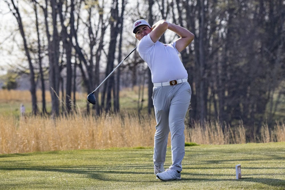 <p>Freshman Drew Salyers follows through with his swing after hitting the ball during the Hoosier Collegiate Invitational Sunday at the Pfau Course. The Hoosiers finished second in the invitational.</p>