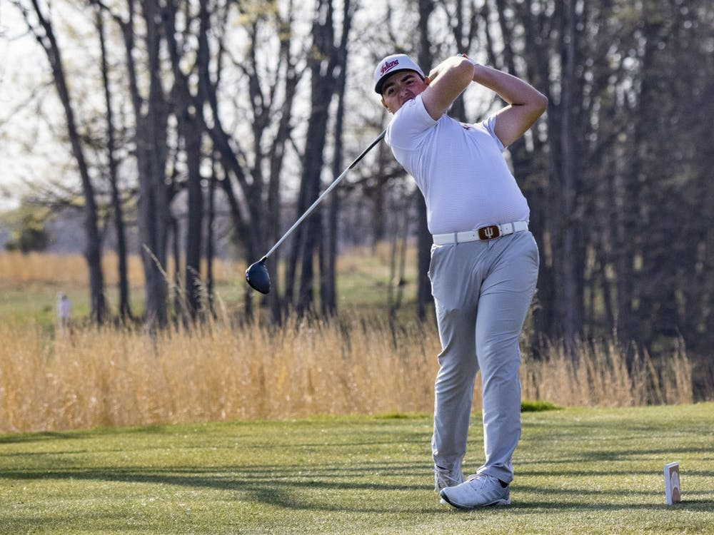 Freshman Drew Salyers follows through with his swing after hitting the ball during the Hoosier Collegiate Invitational Sunday at the Pfau Course. The Hoosiers finished second in the invitational.