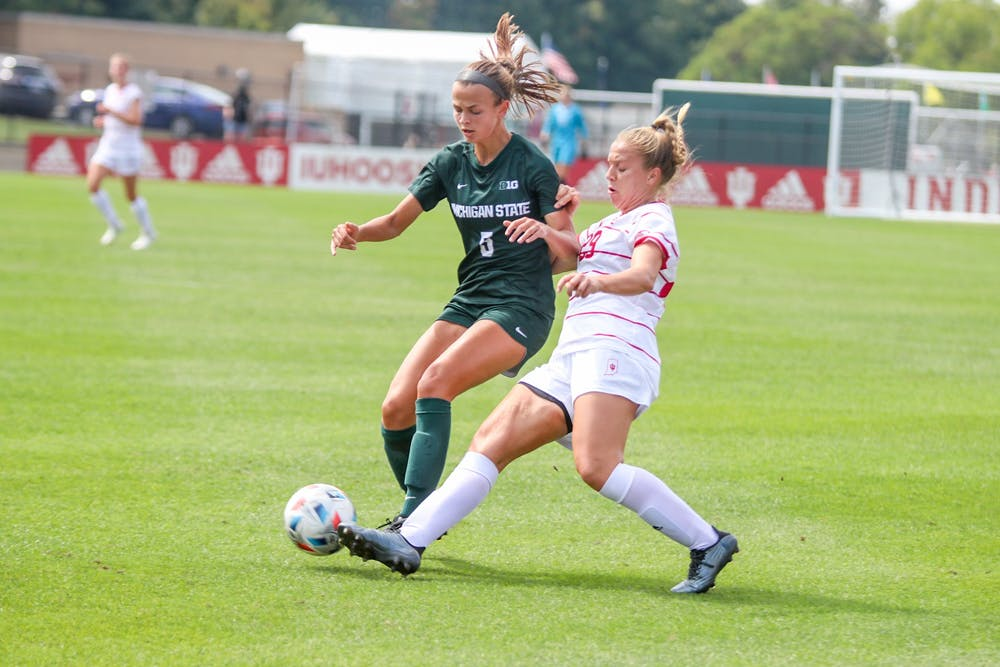 <p>Junior midfielder Alaina Kalin kicks the ball Sept. 19, 2021, in Bill Armstrong Stadium. IU lost to Michigan State University 1-0. </p>