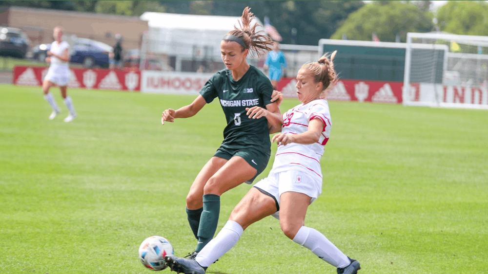 Junior midfielder Alaina Kalin kicks the ball Sept. 19, 2021, in Bill Armstrong Stadium. IU lost to Michigan State University 1-0.