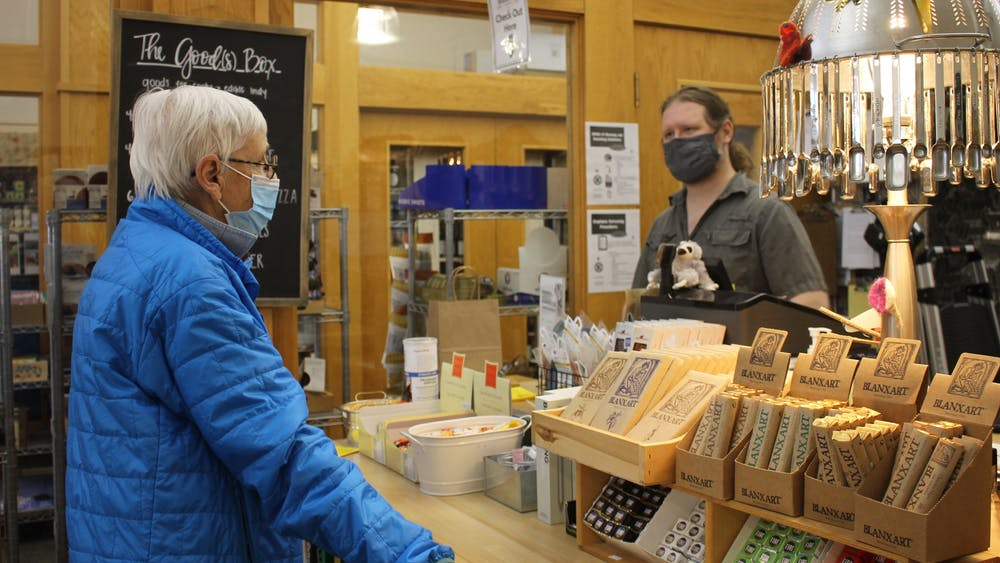 Bloomington resident Pam Gilliatt, 77, wears a mask while browsing in Goods for Cooks and talking to assistant manager Jacob Leaf. The Monroe County Health Department extended its mask mandate until May 28.