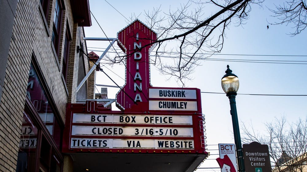 A sign informs readers about the Buskirk-Chumley Theater closing until May 10 on Kirkwood Avenue.  This week community members can bid to choose a positive message to display on the theater's marquee.