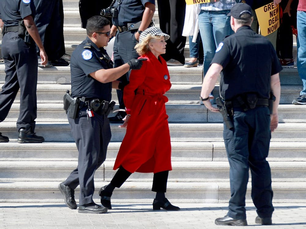 Actress Jane Fonda is arrested for blocking a street in front of the U.S. Capitol on Oct. 18 during a climate change protest and rally on Capitol Hill, in Washington, D.C. Protesters are demanding urgent action on adapting the Green New Deal, implementing clean, renewable energy, and ending all new fossil fuel exploration and drilling.