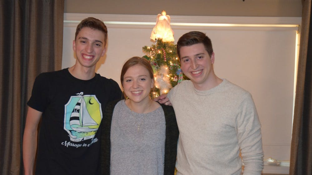 Sophomore Alex Reed, left, poses for a photo with his sister Hannah Reed and brother David Reed. Hannah is a senior studying journalism, Alex is a sophomore studying Informatics and David is an IU alumnus.
