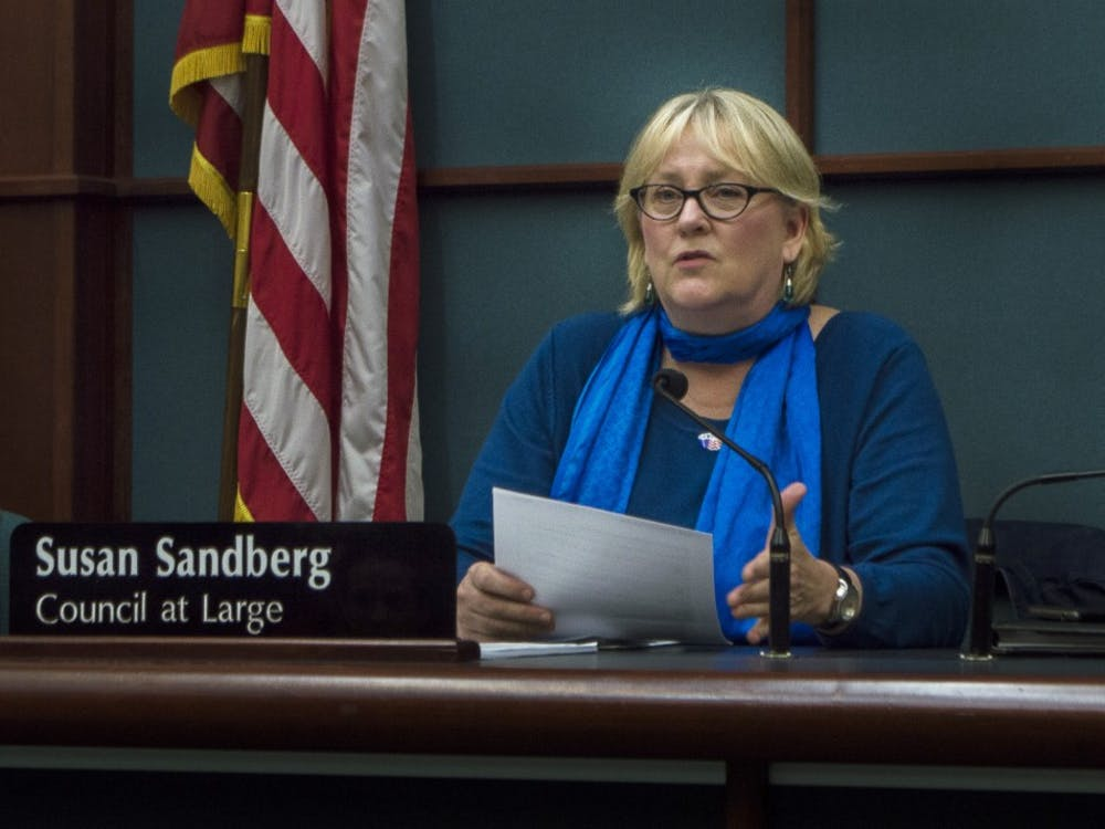 Susan Sandberg discusses wages for firefighters and police officers Oct. 8, 2014, at the City Council Meeting in City Hall. When Sandberg joined Bloomington City Council, it was an all male council.