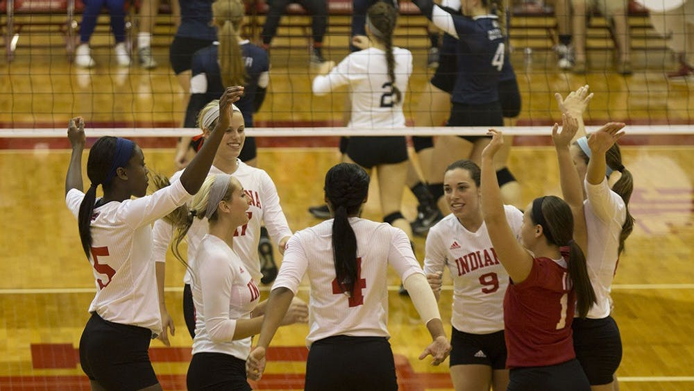 Members of IU's volleyball celebrate during their game versus Butler on Saturday night. The Hoosiers defeated the Bulldogs and won the weekend's Hoosier Classic 2-1.