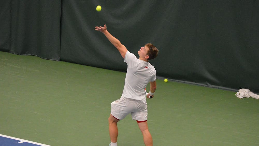Senior Andrew Redding serves the ball April 11 at the IU Tennis Center. The IU men's tennis team will play No. 16 Illinois on Saturday at home to close out the regular season.