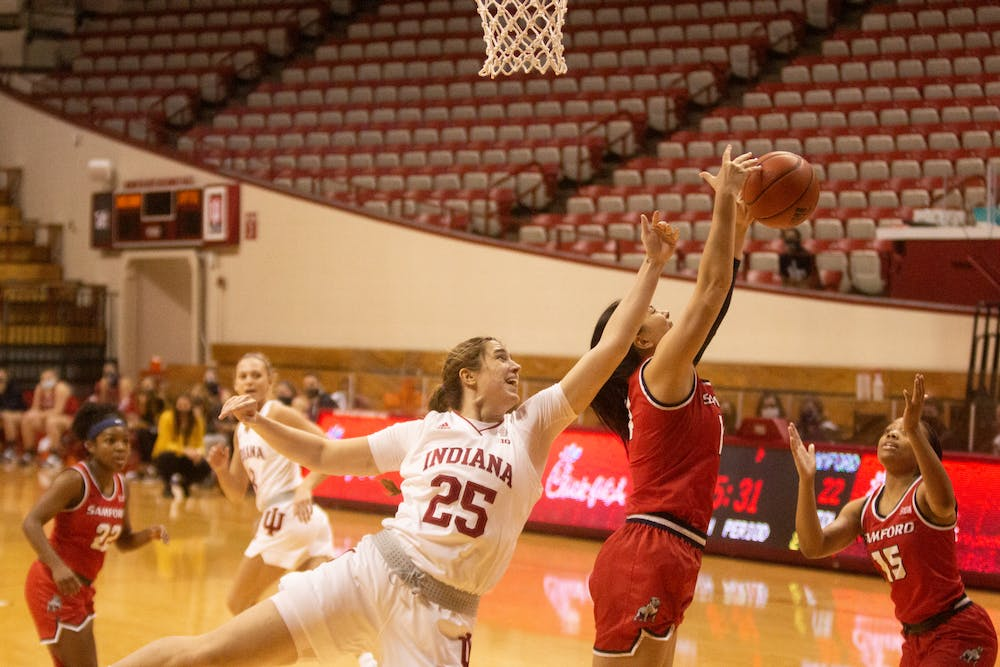 <p>Redshirt freshman Arielle Wisne attempts to take the ball from a Samford University player Dec. 3 in Simon Skjodt Assmebly Hall. IU defeated Samford 71-26. </p>