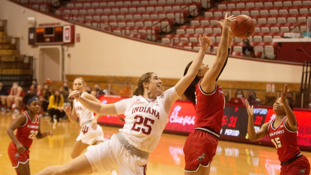 Redshirt freshman Arielle Wisne attempts to take the ball from a Samford University player Dec. 3 in Simon Skjodt Assmebly Hall. IU defeated Samford 71-26.