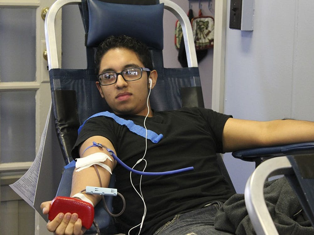 Freshman Brayan Marino gives blood at La Casa on Tuesday. This is his first time donating blood since he has come to Indiana University.
