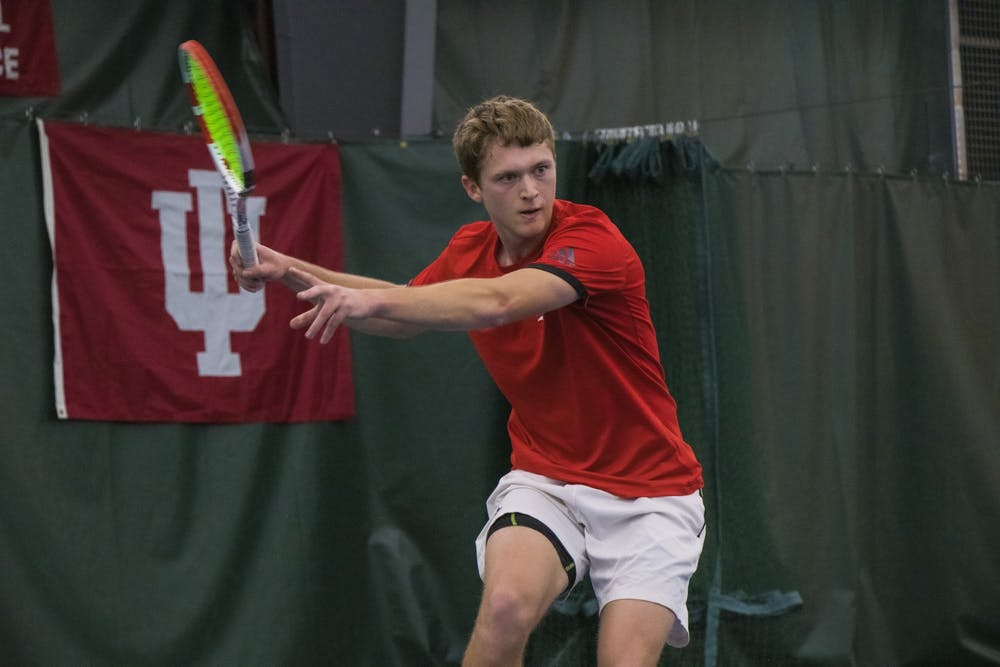 <p>IU tennis player Carson Haskins watches the ball against the University of Notre Dame Feb. 1, 2020, at the IU Tennis Center. The Hoosiers played at the Badger Invitational last weekend in Madison, Wisconsin.</p>