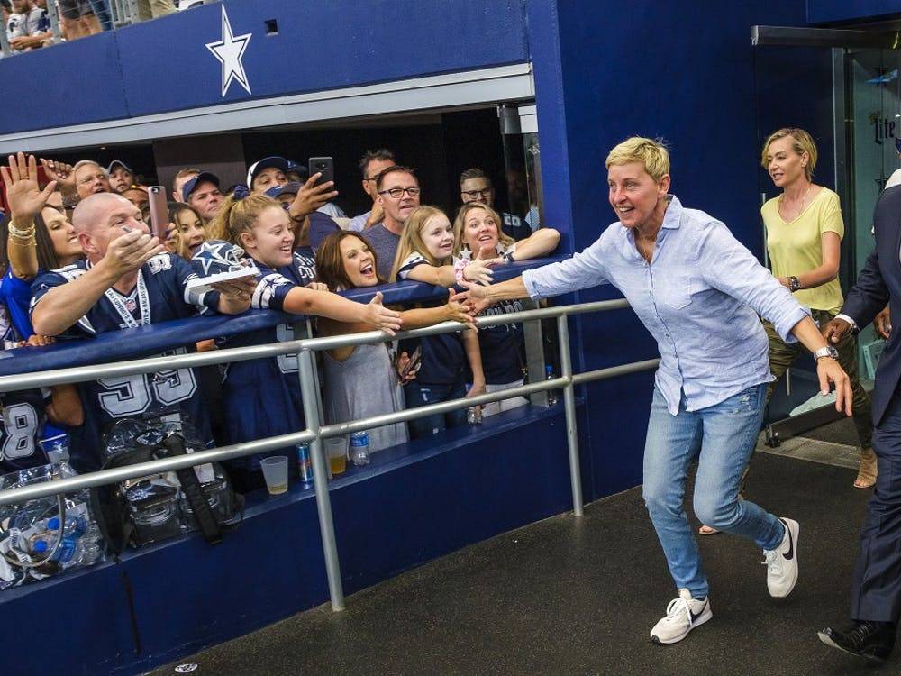 Ellen DeGeneres high-fives fans before an NFL game between the Dallas Cowboys and the Green Bay Packers on Oct. 6 in AT&T Stadium in Arlington, Texas.