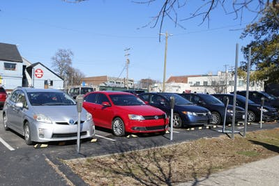 The parking lot on Fourth and Dunn streets sits completely full Feb. 22 in Bloomington. The lot is in the process of transitioning to a pay station instead of individual meters.