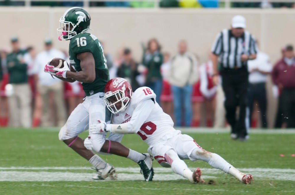 Senior wide receiver Aaron Burbridge gets tackled by Indiana wide receiver Isaac Griffith during the game against Indiana on Oct. 24, 2015 at Spartan Stadium. The Spartans defeated the Hoosiers, 52-26.