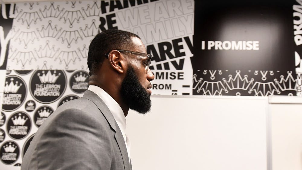 LeBron James prepares for a news conference in a classroom July 29, 2018, at the I PROMISE School in Akron, Ohio. James has faced backlash for a controversial tweet he posted targeting the police officer, Nicholas Reardon, who shot and killed 16-year-old Ma'Khia Bryant on April 20 in Columbus, Ohio.
