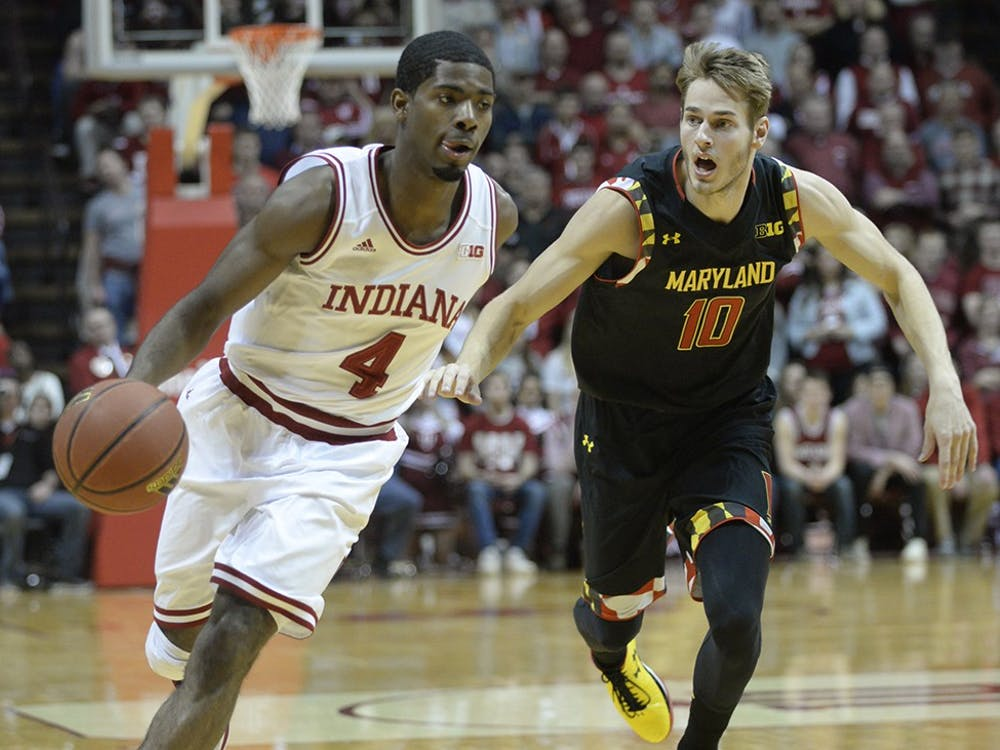 Freshman Rob Johnson dribbles past his defender during IU's game against Maryland on Thursday at Assembly Hall.