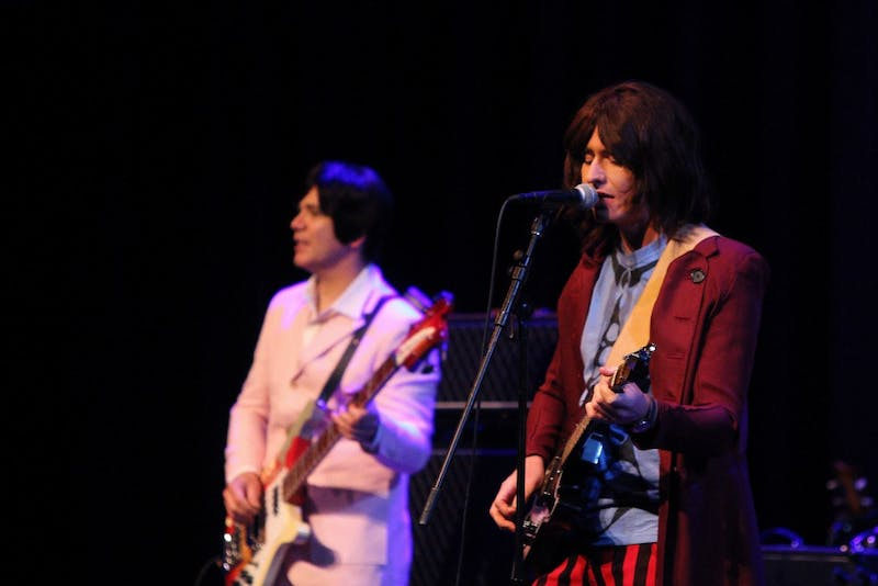 Craig McGown, portraying George Harrison, plays the guitar with The Mersey Beatles on Oct. 12 at the Buskirk-Chumley Theater. The band is from Liverpool, England, and it has played around the world.