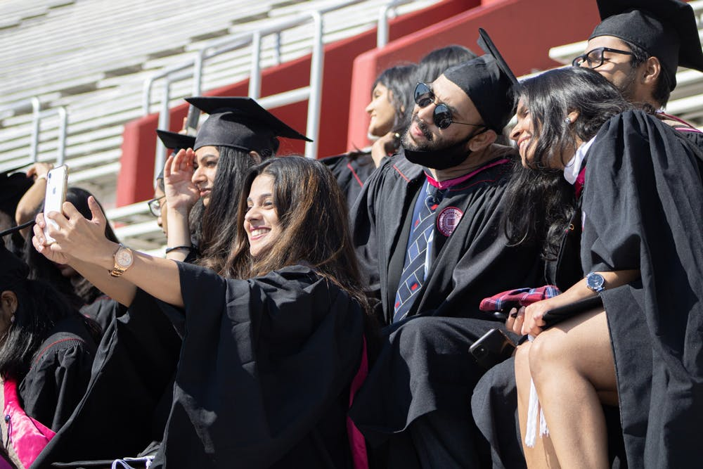 Graduates of the Kelley School of Business Masters of Science in Information Systems  program pose for a picture May 7. IU awarded 9,714 degrees to students during the in-person undergraduate ceremony May 8.