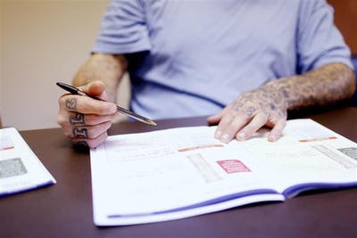 A Monroe County Drug Court Treatment Program participant fills out a worksheet during a journal session on April 21at the Community Corrections Building. Journaling is a time when participants learn to recognize addictive thinking. This is Monroe County's first group journaling session, taught by Case Manager Brier Frasier.