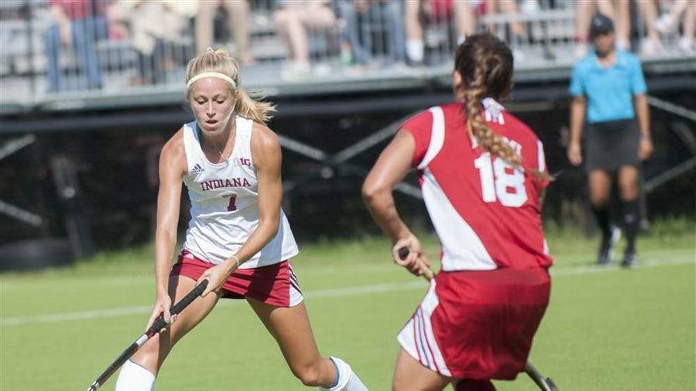 Junior Corinne Karch moves past a Redhawk defender during IU's game against Miami of Ohio on Sept. 27 at the IU Field Hockey Complex.