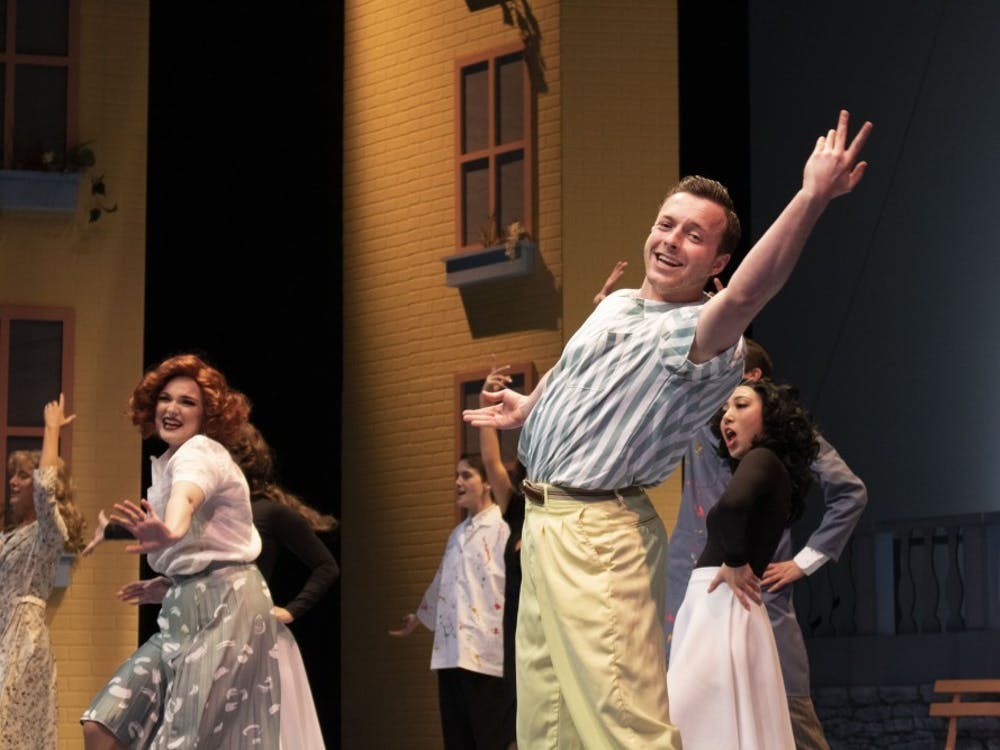 """Henry Miller and other student actors prepare themselves on Monday's dress rehearsal for """"Wonderful Town,"""" which opens April 12 at the Ruth N. Halls Theatre. The musical delves into the bright, colorful life of 1950s Greenwich Village, New York."""