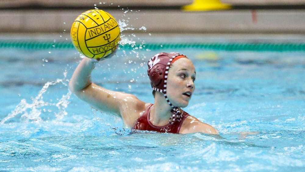 <p>Junior Tina Doherty prepares to throw the ball during a water polo match against San Jose State on Saturday in San Jose, California. The Hoosiers won 12-8 on Saturday.</p>