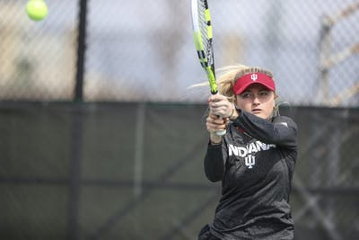 Then-junior Madison Appel hits the ball during the Hoosiers match against the Iowa Hawkeyes.