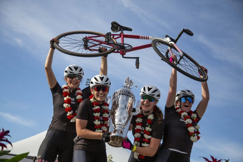 Members of Teter Cycling hold up the 2019 women's Little 500 trophy April 12, at Bill Armstrong Stadium. Delta Gamma placed second, and SKI placed third.