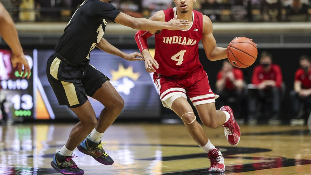 IU freshman Khristian Lander dribbles the ball during the game between the Purdue Boilermakers and the Indiana Hoosiers Saturday at Mackey Complex in West Lafayette, Indiana. Purdue beat IU 67-58.