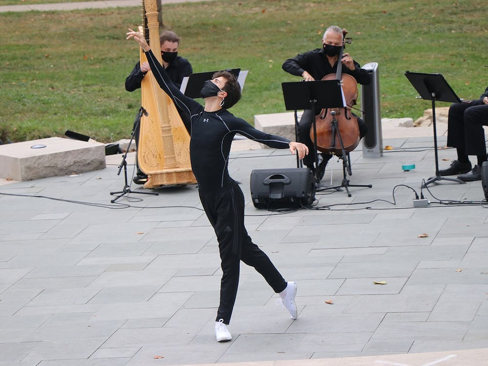 """Senior Sam Epstein dances at an outdoor performance titled """"Meditation on Resilience"""" on Oct. 2 at the Conrad Prebys Ampitheater. The speaker at the event talked about how resilience is needed during the time of COVID-19 and how the IU ballet community exhibited resilience."""