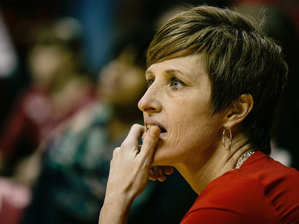 Head coach Teri Moren takes a knee at the edge of the court during the fourth quarter of play on Feb. 4, at Assembly Hall. The Hoosiers held on late to beat the Iowa Hawkeyes 79-74.