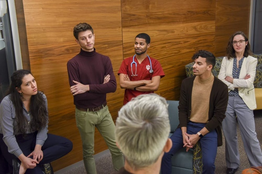 <p>Dustin Nowaskie, IU medical student and founder of OutCare Health, talks with IU School of Medicine leaders and LGBTQ members to work to increase the amount of LGBTQ education and training on December 10, 2019. The IU School of Medicine will hold its fourth annual LGBTQ Virtual Health Conference this week. </p>