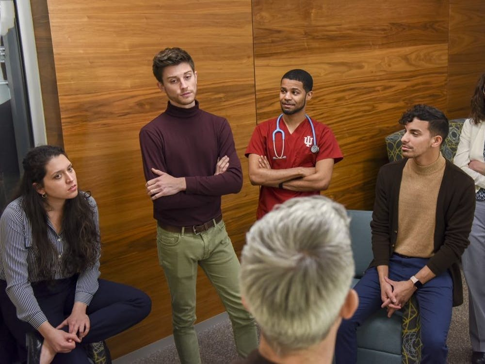 Dustin Nowaskie, IU medical student and founder of OutCare Health, talks with IU School of Medicine leaders and LGBTQ members to work to increase the amount of LGBTQ education and training on December 10, 2019. The IU School of Medicine will hold its fourth annual LGBTQ Virtual Health Conference this week.