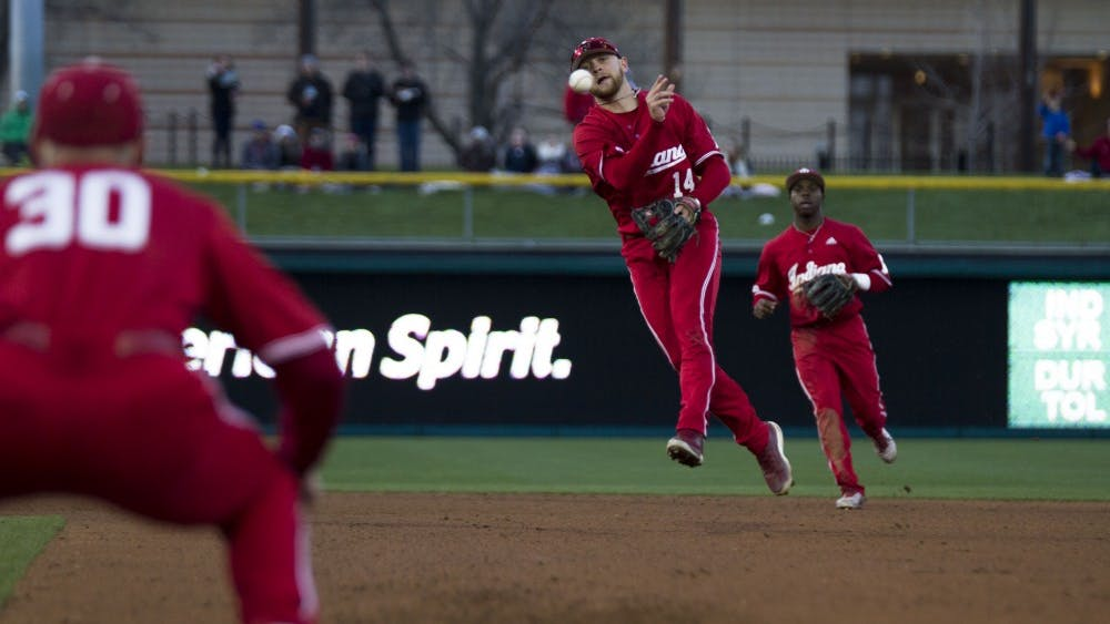Junior utility player Matt Lloyd throws the ball to first base to get the out during the April 17 game against Notre Dame at Victory Field in Indianapolis. Lloyd hit a three-run home run in IU's win against Texas A&M on Sunday.