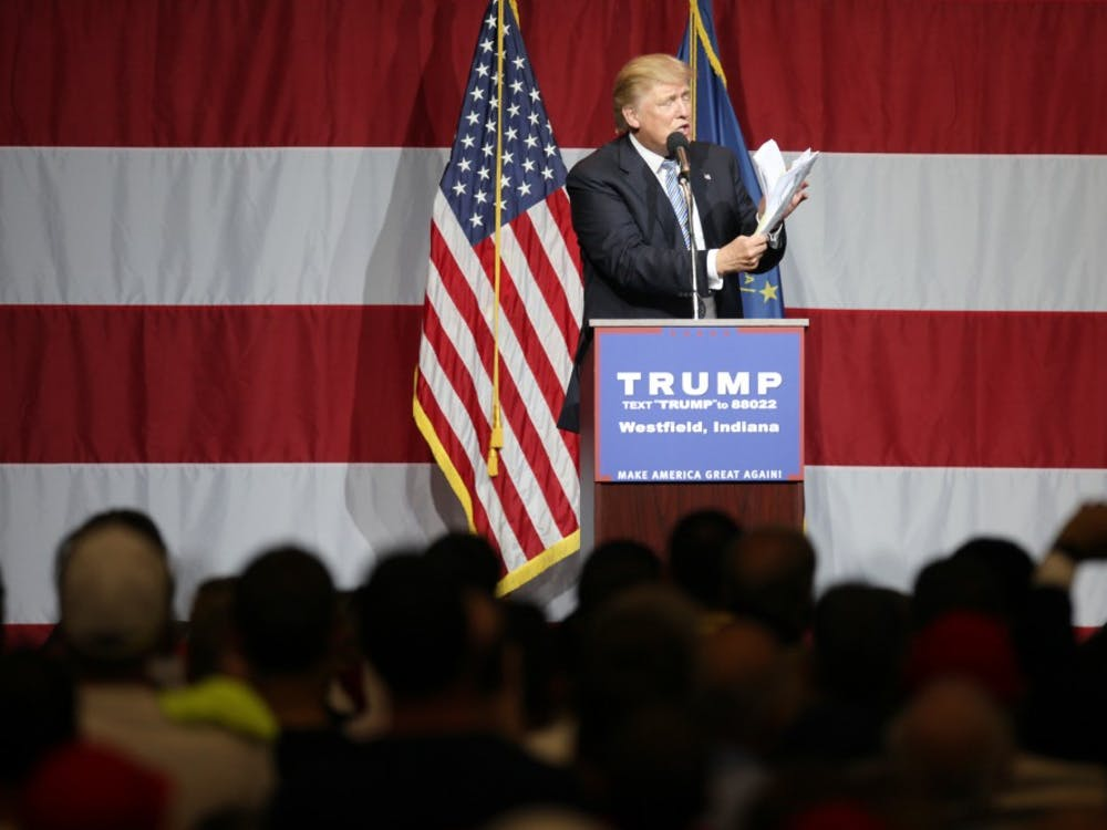 """Donald Trump, republican presidential candidate, holds a stack of papers to reference, """"all of the lies the Hillary has told,"""" during a Trump rally in Westfield, Ind. on Tuesday evening."""