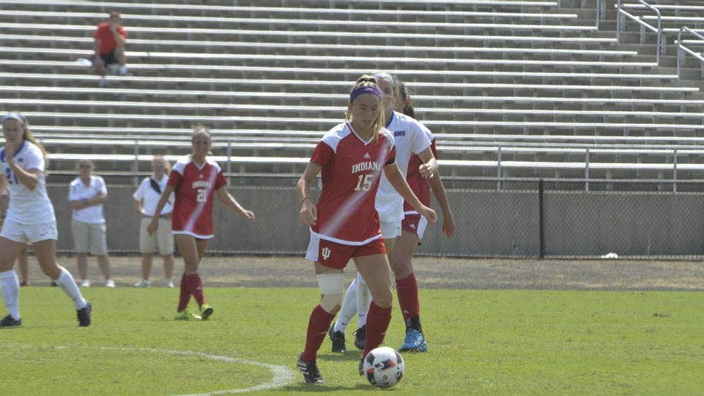 Veronica Ellis dibbles the ball down the field during Monday's match against Southern Methodist University at Bill Armstrong Stadium. Ellis scored the  goal made by IU during the game which ended with SMU winning by one.