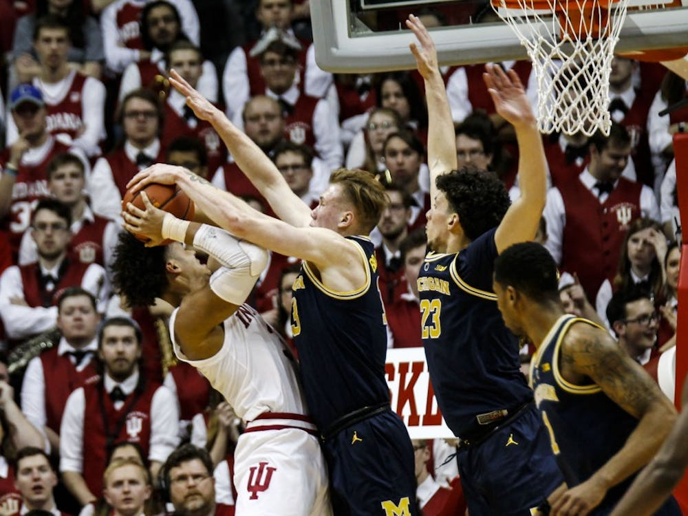 Sophomore forward Justin Smith tries to make a basket, but blocked by a Michigan player on Jan. 25 at Simon Skjodt Assembly Hall. IU lost to Michigan, 69-46.