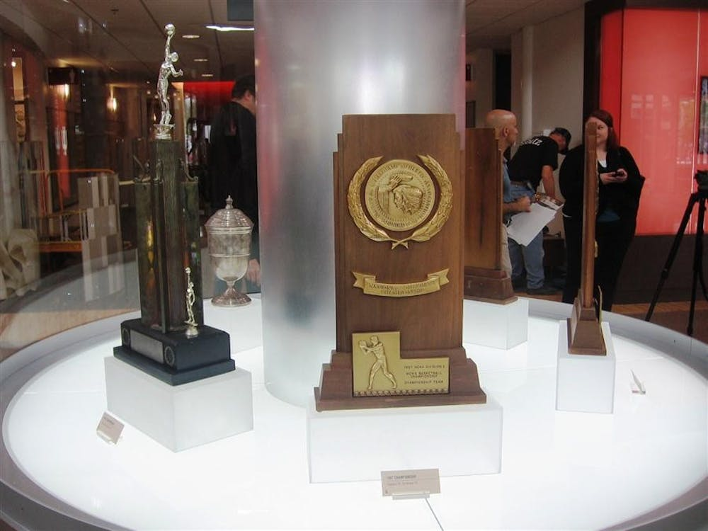The 1987 national championship trophy at the bottom of the IU Tower in Cook Hall. The other four trophies run clockwise around the tower, beginning with the 1940 trophy pictured to its left.