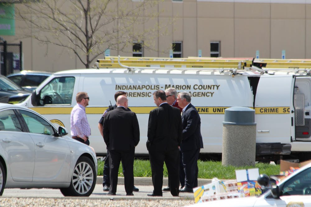 <p>Indianapolis Metropolitan Police personnel talk outside of the FedEx Ground center Friday in Indianapolis. The FedEx center was the site of a mass shooting Thursday, where a gunman killed eight people and then himself.</p>