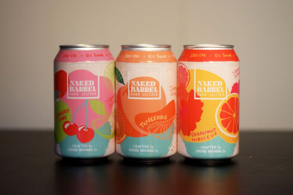 <p>Three cans of Upland Brewing Company&#x27;s Naked Barrel Hard Seltzer are lined up Wednesday in a student&#x27;s house. Upland, located in several places around Indiana, launched its new seltzer brand in January. </p>